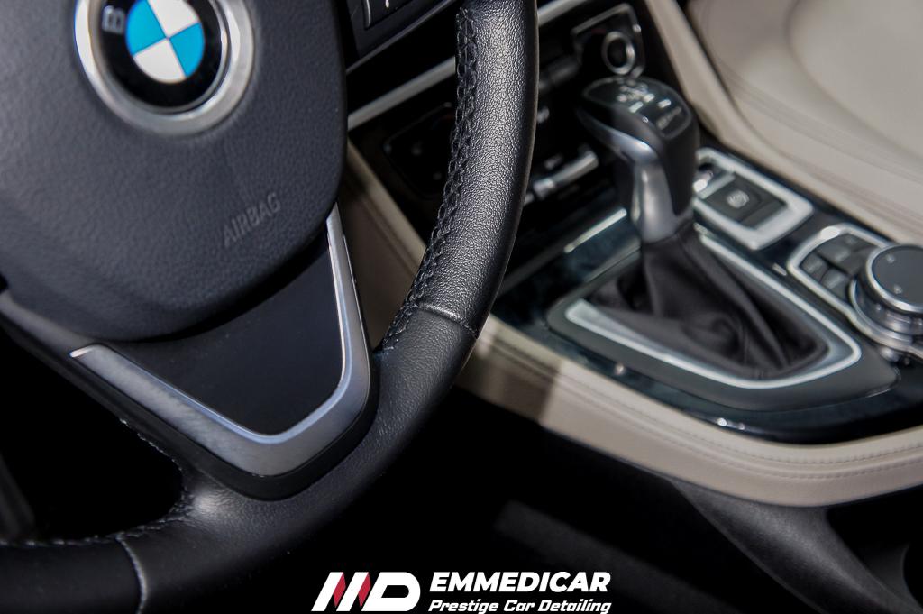 BMW 225 IBRID, PULIZIA VOLANTE AUTO